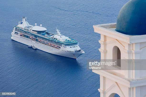 Santorini cruise ship Rhapsody of the seas with church tower