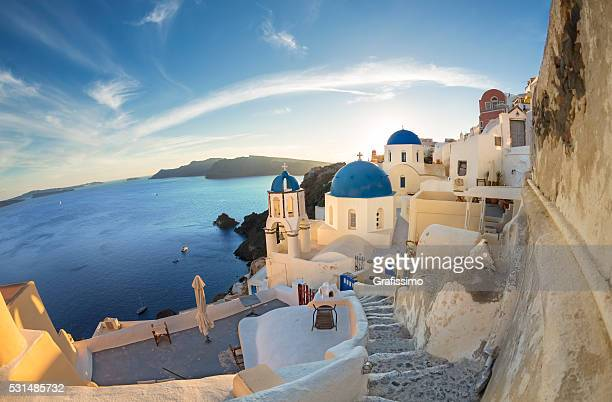 Santorini sunset bell tower and domes in Oia on Greece