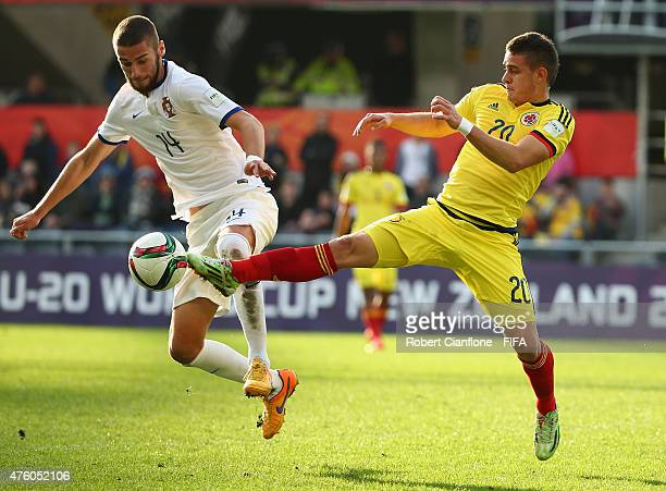 Santos Borre of Colombia is challenged by Domingos Duarte of Portugal during the FIFA U20 World Cup New Zealand 2015 Group C match between Colombia...