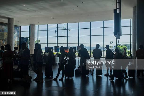Santos Dumont airport exterior area passengers at taxi queue Rio de Janeiro Brazil