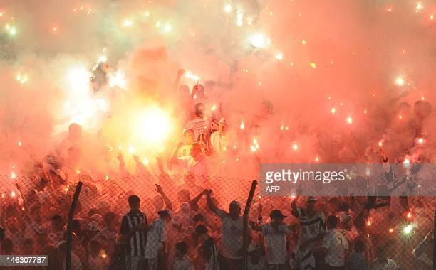 Santos fans celebrate before their match against Corinthians during their Copa Libertadores football semifinal first match at the Vila Belmiro...