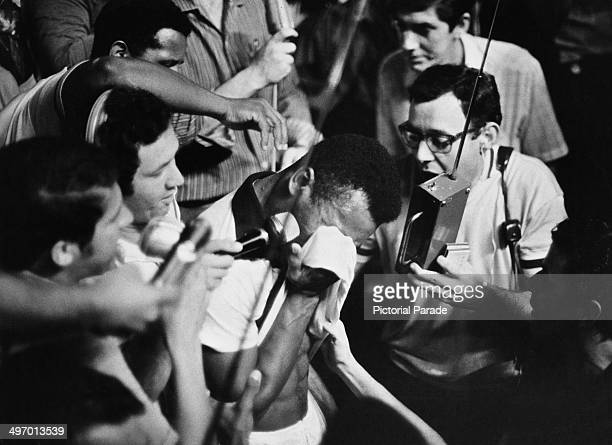 Santos FC player Pele cries after scoring the 1000th goal of his career during a game against Vasco da Gama at the Maracana Stadium Rio de Janeiro...