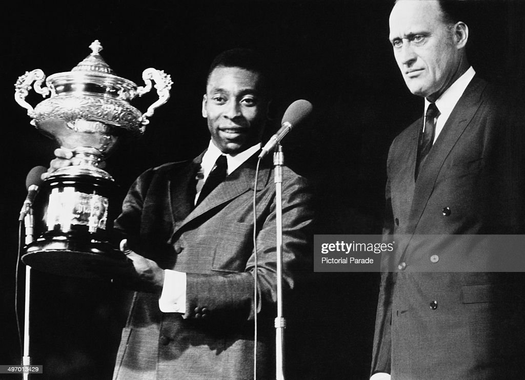 Santos FC player Pele receives the Garratazu Medici Cup to celebrate scoring 1,000 goals in his career, 3rd January 1970. He is with <a gi-track='captionPersonalityLinkClicked' href=/galleries/search?phrase=Joao+Havelange&family=editorial&specificpeople=552184 ng-click='$event.stopPropagation()'>Joao Havelange</a>, President of the Brazilian Sports Federation.