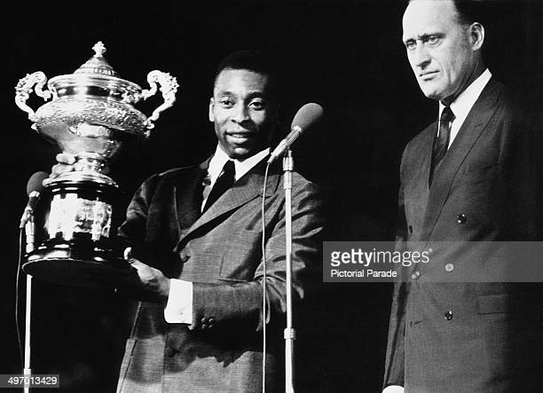 Santos FC player Pele receives the Garratazu Medici Cup to celebrate scoring 1000 goals in his career 3rd January 1970 He is with Joao Havelange...
