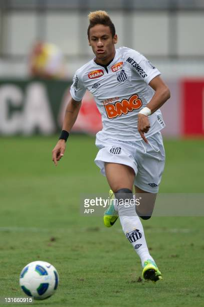 Santos' Neymar chases the ball during a football match against Vasco at Vila Belmiro stadium on November 6 2011 in Santos Brazil Santos won by 20 AFP...