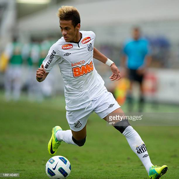 Santos' Neymar controls the ball during a football match against Vasco at Vila Belmiro stadium on November 6 2011 in Santos Brazil Santos won by 20...