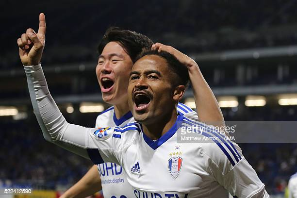 Santos of Suwon Samsung Bluewings celebrates after scoring a goal to make it 01 during the AFC Champions League Group G match between Gamba Osaka and...