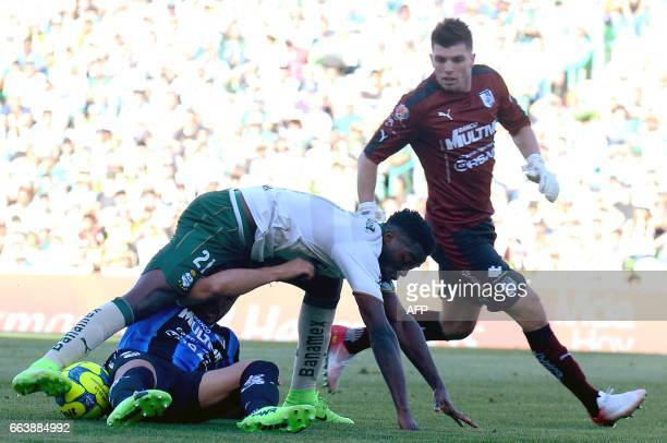 Santos player Djaniny Tavares and goalkeeper Tiago Volpi vie for the ball with Jonathan Bornstein of Queretaro during their Mexican Clausura 2017...