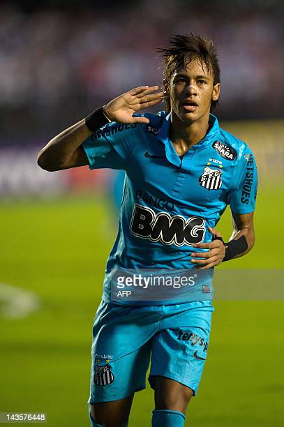 Santos player Neymar celebrates after his 3rd goal against Sao Paulo during a Paulista championship match at Morumbi stadium in Sao Paulo Brazil on...