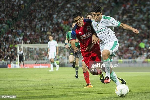 Santos's defender Nestor Araujo vies for the ball with Guadalajara's defender Jesus Sanchez during their Mexican Clausura tournament football match...