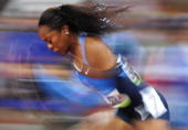 Sanya Richards of the US competes during the women's 400m final at the 'Bird's Nest' National Stadium during the 2008 Beijing Olympic Games on August...