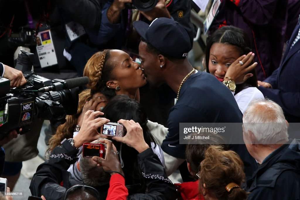 <a gi-track='captionPersonalityLinkClicked' href=/galleries/search?phrase=Sanya+Richards&family=editorial&specificpeople=239062 ng-click='$event.stopPropagation()'>Sanya Richards</a>-Ross of the United States kisses her husband and NFL Cornerback <a gi-track='captionPersonalityLinkClicked' href=/galleries/search?phrase=Aaron+Ross&family=editorial&specificpeople=2105852 ng-click='$event.stopPropagation()'>Aaron Ross</a> after winning the Women's 400m final on Day 9 of the London 2012 Olympic Games at the Olympic Stadium on August 5, 2012 in London, England.