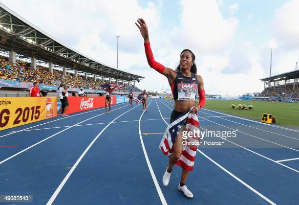 Sanya RichardsRoss of the United States waves to fans as she rounds the track after winning the Women's 4x400 metres relay final during day two of...