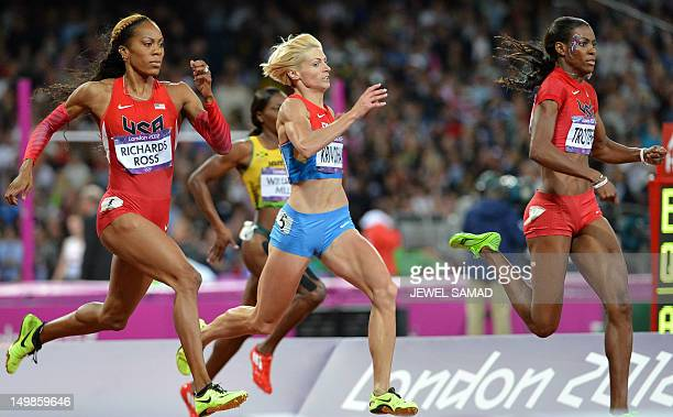 US' Sanya RichardsRoss Russia's Antonina Krivoshapka and US' Deedee Trotter compete in the women's 400m final at the athletics event during the...