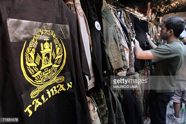 A customer looks for jackets beside a Tshirt with the Afghanistan's Taliban logotype at an military supply shop in Sao Paulo Brazil 28 July 2006...