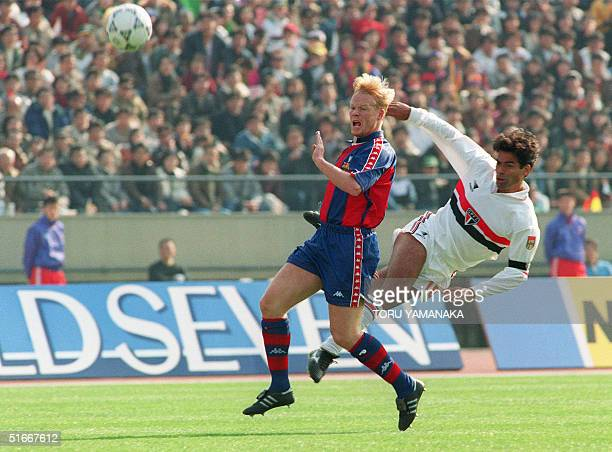 Sao Paulo Captain and star striker Rai steals the ball from Barcelona's defence Ronald Koeman during the first quarter of Toyota European/South...