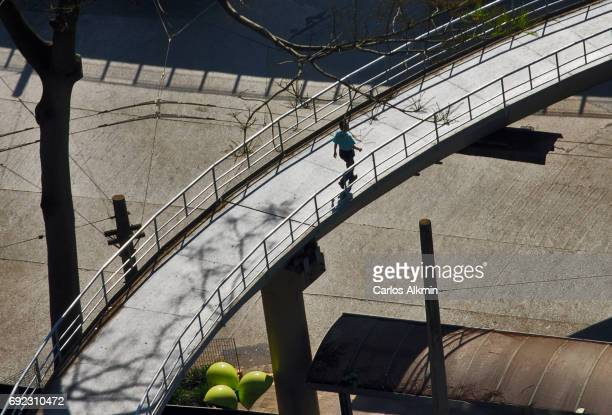 Sao Paulo downtown - lonely man crossing a curved footbridge