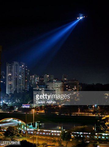 Sao Paulo night, police helicopter over station