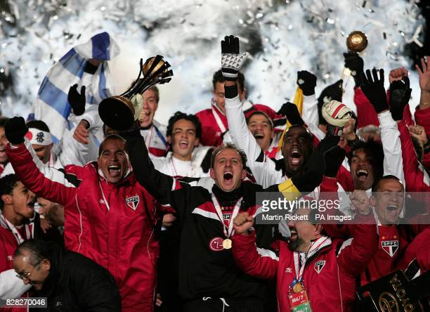 Sao Paulo's Ceni Rogerio lifts the trophy after winning the FIFA World Championship Final against Liverpool at the Yokohama International Stadium in...