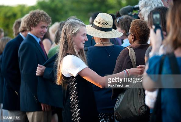 Saoirse Kennedy age 12 and Max Kennedy Jr age 15 children of Max Kennedy Kennedy Jr greet people waiting in line to pass by the casket containing the...