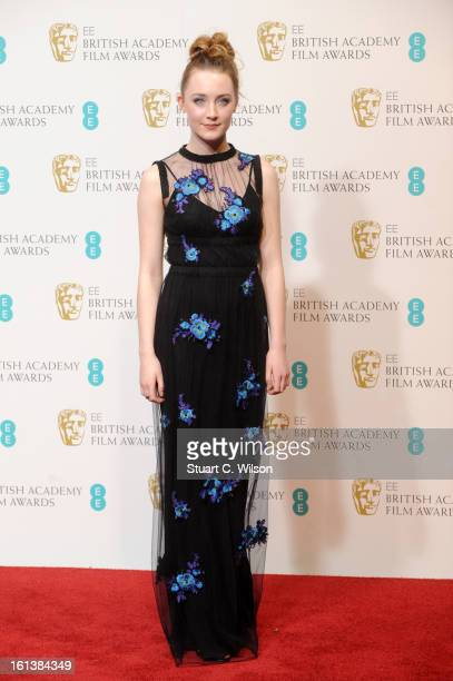 Saoirse Ronan poses in the press room at the EE British Academy Film Awards at The Royal Opera House on February 10 2013 in London England