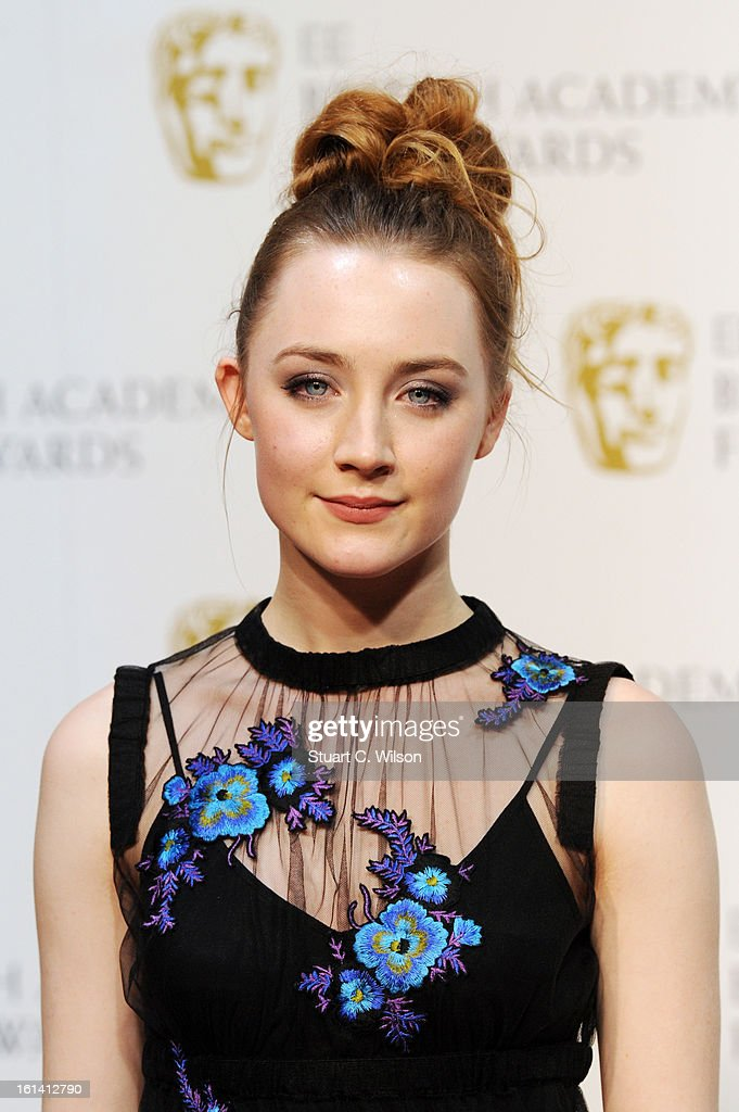 <a gi-track='captionPersonalityLinkClicked' href=/galleries/search?phrase=Saoirse+Ronan&family=editorial&specificpeople=4475637 ng-click='$event.stopPropagation()'>Saoirse Ronan</a> poses in the press room at the EE British Academy Film Awards at The Royal Opera House on February 10, 2013 in London, England.