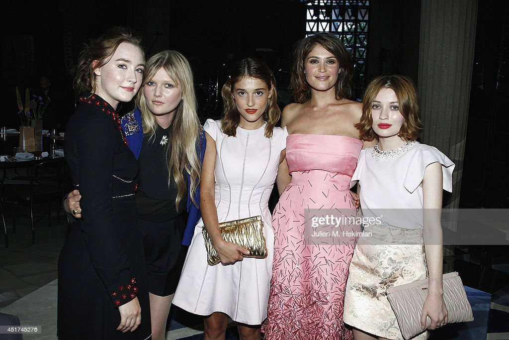 <a gi-track='captionPersonalityLinkClicked' href=/galleries/search?phrase=Saoirse+Ronan&family=editorial&specificpeople=4475637 ng-click='$event.stopPropagation()'>Saoirse Ronan</a>, <a gi-track='captionPersonalityLinkClicked' href=/galleries/search?phrase=Sophie+Kennedy+Clark&family=editorial&specificpeople=7256528 ng-click='$event.stopPropagation()'>Sophie Kennedy Clark</a>, Lola Bessis, <a gi-track='captionPersonalityLinkClicked' href=/galleries/search?phrase=Gemma+Arterton&family=editorial&specificpeople=4296305 ng-click='$event.stopPropagation()'>Gemma Arterton</a> and <a gi-track='captionPersonalityLinkClicked' href=/galleries/search?phrase=Emily+Browning&family=editorial&specificpeople=214573 ng-click='$event.stopPropagation()'>Emily Browning</a> attend the Miu Miu Resort Collection 2015 at Palais d'Iena on July 5, 2014 in Paris, France.