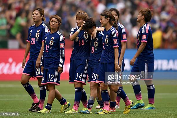 Saori Ariyoshi and Asuna Tanaka of Japan react after losing to the United States 52 in the FIFA Women's World Cup Canada 2015 Final at BC Place...