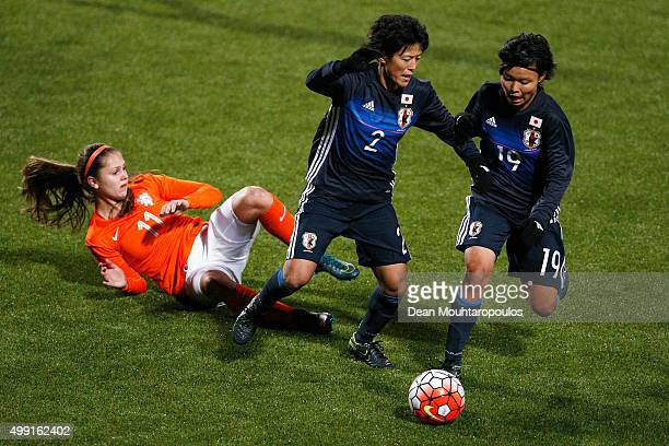 Saori Ariyoshi and Rika Masuya of Japan beat Lieke Martens of the Netherlands to the ball during the International Friendly match between Netherlands...