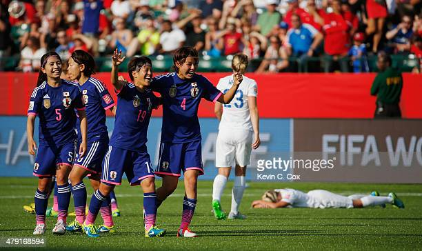 Saori Ariyoshi and Saki Kumagai of Japan celebrate after the FIFA Women's World Cup Semi Final match between Japan and England at the Commonwealth...