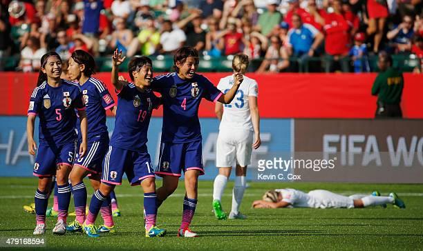 Saori Ariyoshi and Saki Kumagai of Japan celebrate after the FIFA Women's World Cup Semi Final match between Japan and England at the Commonwealth...