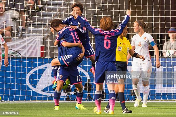 Saori Ariyoshi of Japan celebrates with Yuki Ogimi Shinobu Ohno and Mizuho Sakaguchi after scoring against the Netherlands during the FIFA Women's...