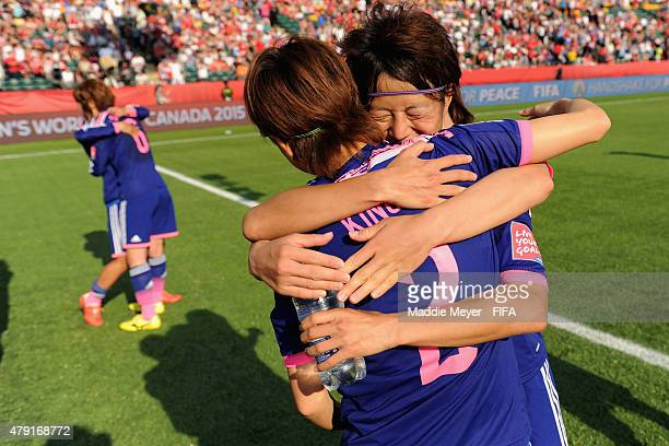 Saori Ariyoshi of Japan celebrates Yukari Kinga after their 21 win over England in the FIFA Women's World Cup Canada 2015 semi final match at...
