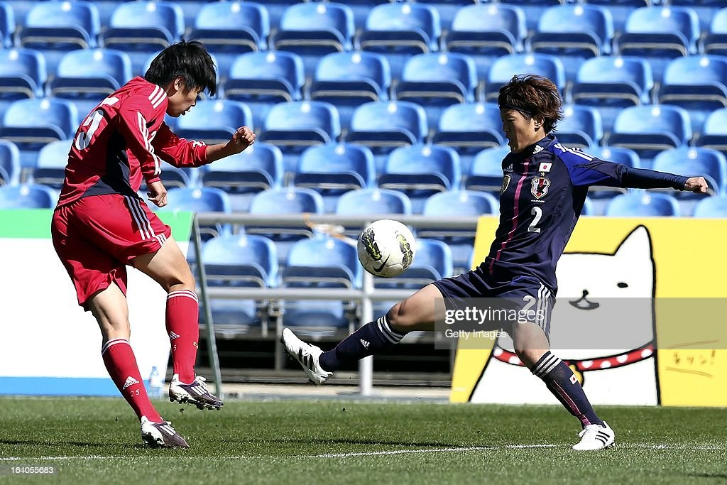 Saori Ariyoshi of Japan challenges Zhang Rui of China during the Algarve Cup 2013 fifth place match at the Estadio Algarve on March 13, 2013 in Faro, Portugal.
