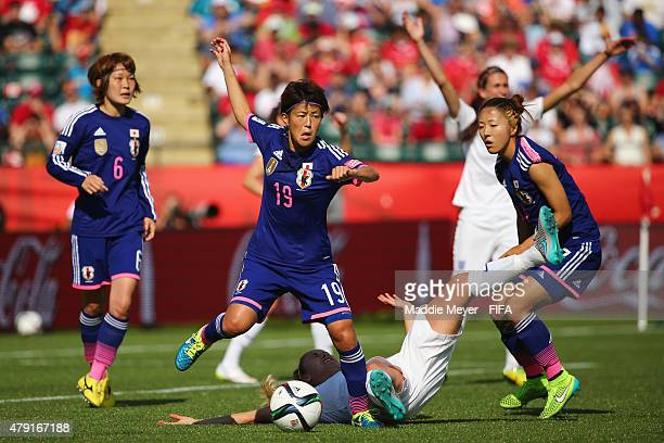 Saori Ariyoshi of Japan looks to clear the ball during the FIFA Women's World Cup Canada 2015 semi final match between England and Japan at...