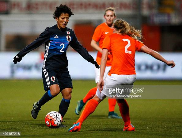 Saori Ariyoshi of Japan runs at Desiree van Lunteren of the Netherlands during the International Friendly match between Netherlands and Japan held at...