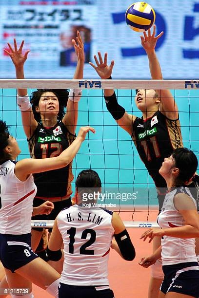 Saori Kimura and Erika Araki of Japan block during the FIVB Women's World Olympic Qualification Tournament match between Japan and South Korea a the...