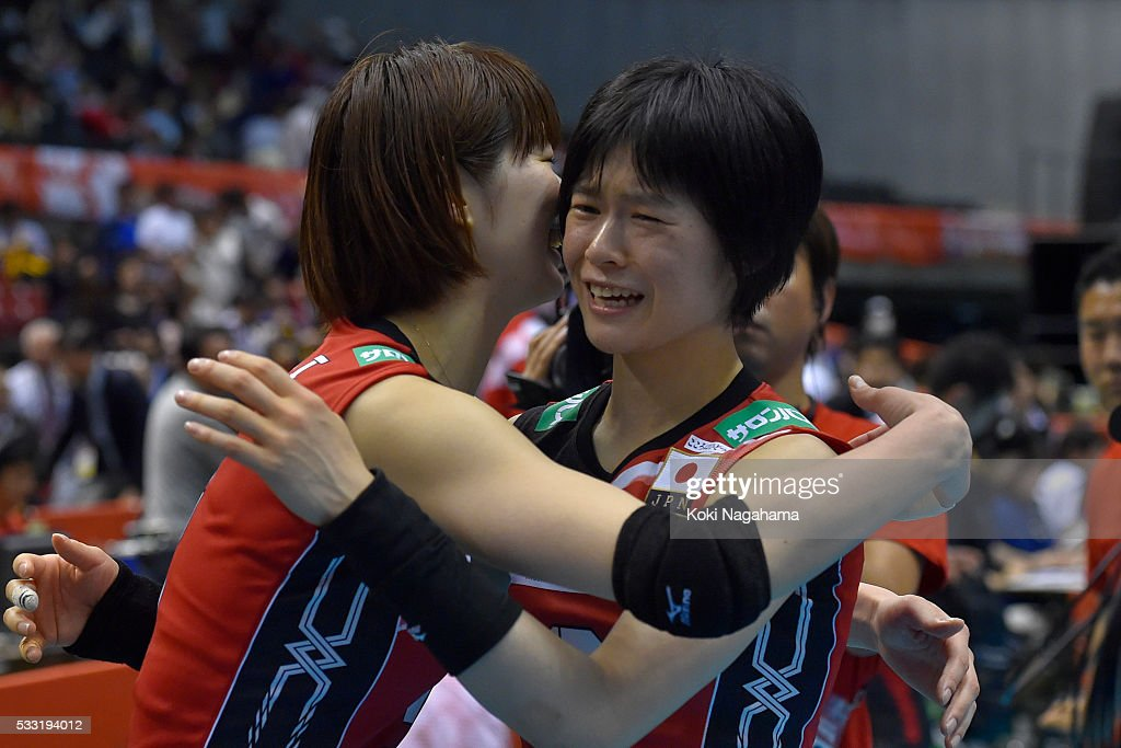 <a gi-track='captionPersonalityLinkClicked' href=/galleries/search?phrase=Saori+Kimura&family=editorial&specificpeople=2151588 ng-click='$event.stopPropagation()'>Saori Kimura</a> #3 and <a gi-track='captionPersonalityLinkClicked' href=/galleries/search?phrase=Haruka+Miyashita&family=editorial&specificpeople=11306800 ng-click='$event.stopPropagation()'>Haruka Miyashita</a> #2 of Japan celebrate their qualification for the Rio de Janeiro Olympicduring the Women's World Olympic Qualification game between Japan and Italy at Tokyo Metropolitan Gymnasium on May 21, 2016 in Tokyo, Japan.
