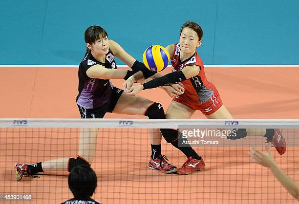 Saori Kimura and Yuko Sano of Japan receive the ball against Turky during the FIVB World Grand Prix Final group one match between Japan and Turkey on...
