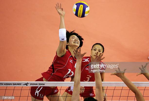 Saori Kimura of Japan attempts a spike in the Women's Gold medal match between China and Japan during the 15th Asian Games Doha 2006 at the AlRayyan...