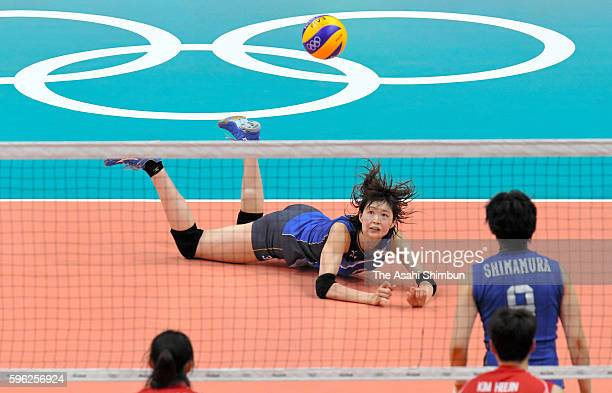 Saori Kimura of Japan dives for the ball during the Women's Preliminary Pool A match between Japan and Korea on Day 1 of the Rio de Janeiro Olympic...
