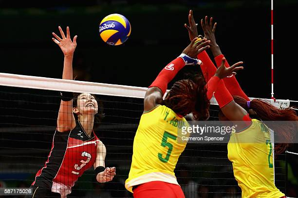 Saori Kimura of Japan plays a shot during the Women's Preliminary Pool A match between Japan and Cameroon on Day 3 of the Rio 2016 Olympic Games at...