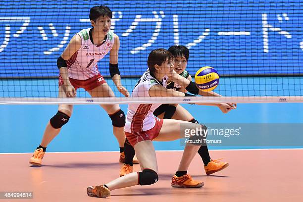 Saori Kimura of Japan receives in the match between Japan and Russia during the FIVB Women's Volleyball World Cup Japan 2015 at Yoyogi National...