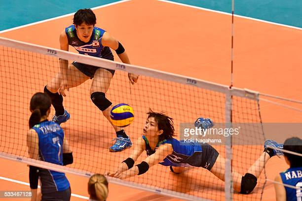 Saori Kimura of Japan sets the ball during the Women's World Olympic Qualification game between Netherlands and Japan at Tokyo Metropolitan Gymnasium...