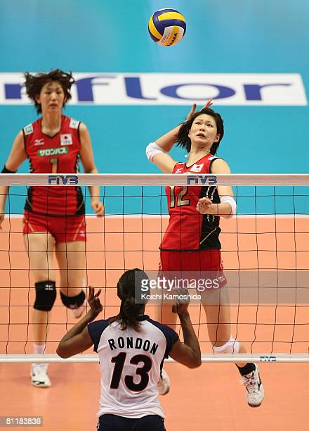 Saori Kimura of Japan spikes the ball against Cindy Rondon Martinez of the Dominican Republic during the FIVB Women's Olympic Qualification...