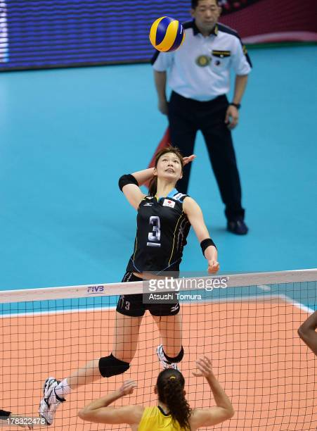 Saori Kimura of Japan spikes the ball during day two of the FIVB World Grand Prix Sapporo 2013 match between Japan and Brazil at Hokkaido Prefectural...