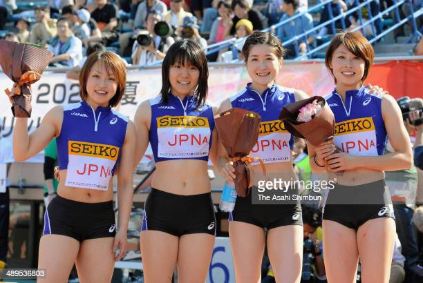 Saori Kitakaze Anna Doi Mayumi Watanabe and Kana Ichikawa of Japan pose for photographs after winning the Women's 4x100m Relay during the Seiko...