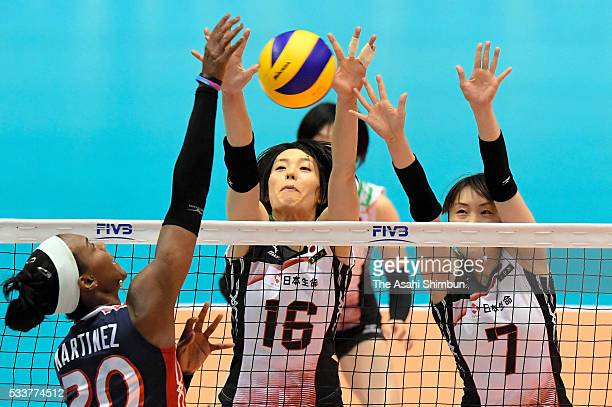 Saori Sakoda and Mai Yamaguchi of Japan jump for a block during the Women's World Olympic Qualification game between Dominican Republic and Japan at...