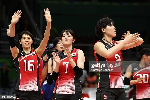 Saori Sakoda Mai Yamaguchi and Haruyo Shimamura of Japan thank the crowd after winning the Women's Preliminary Pool A match between Japan and...