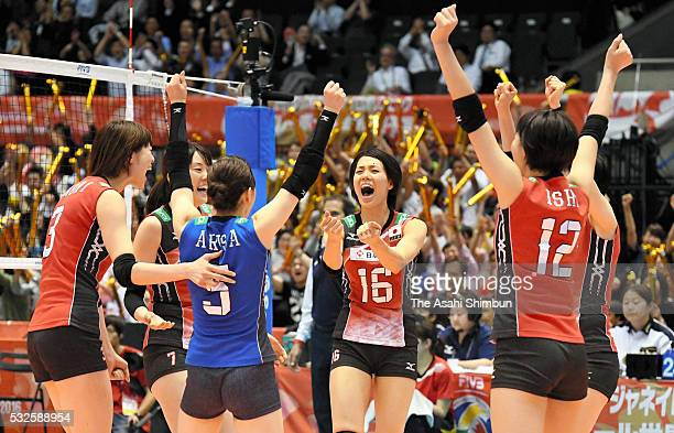 Saori Sakoda of Japan celebrates a point with her team mates during the Women's World Olympic Qualification game between Japan and Thailand at Tokyo...